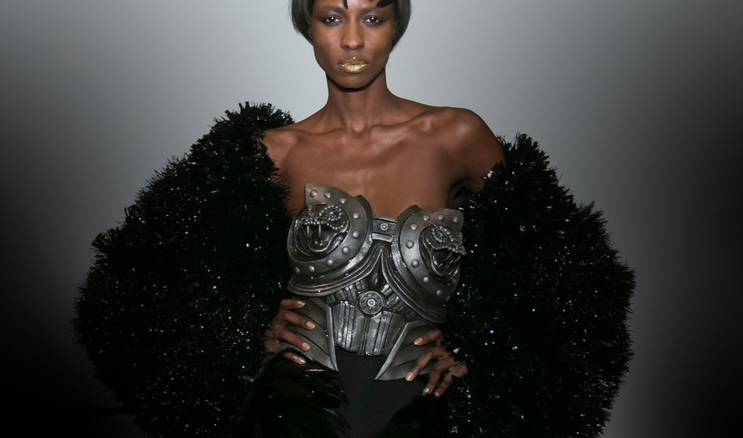 Couture by on aura tout vu black model wearing silver corset and black fur coat