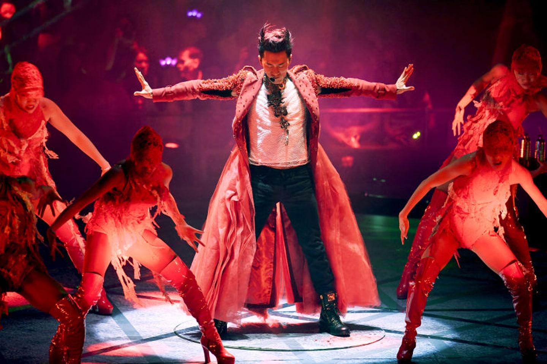 Raymond Lam red coat on aura tout vu couture and accessories hong kong paris