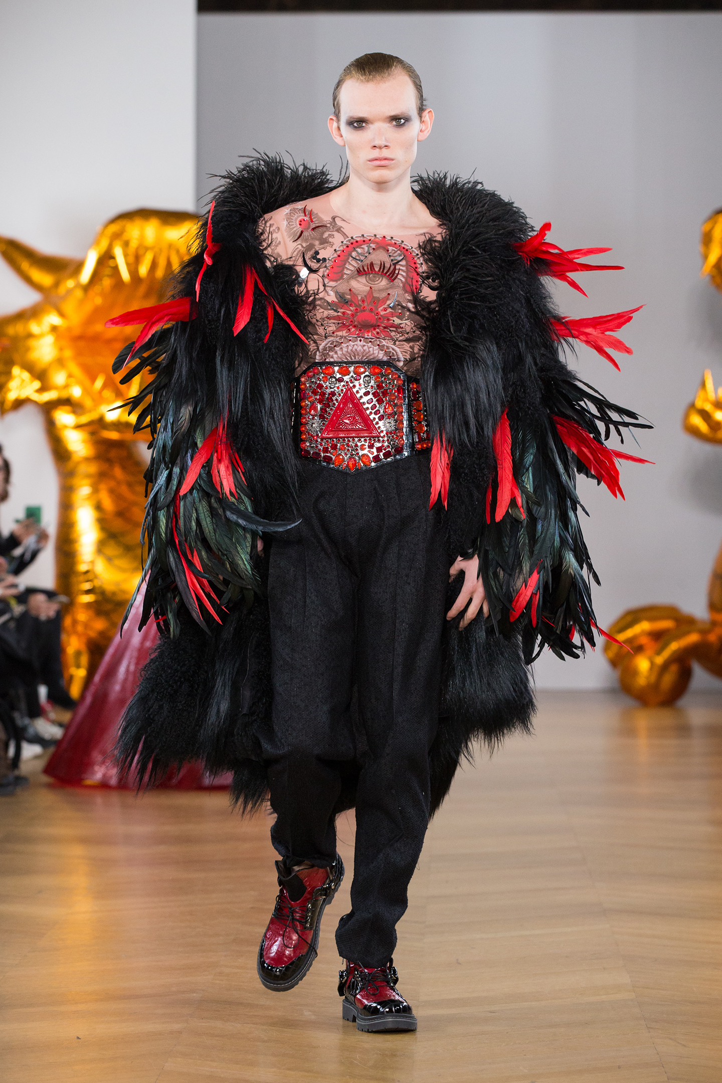 male model wearing feather and fur black red coat tatoo print top by on aura tout vu