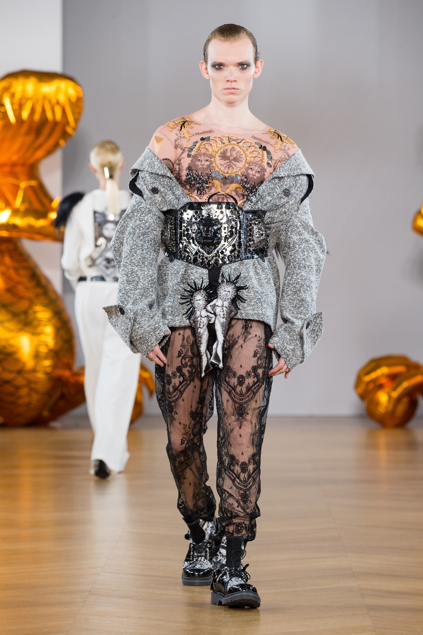 Boy male model wearing couture coat and lace pants crystal belt on aura tout vu
