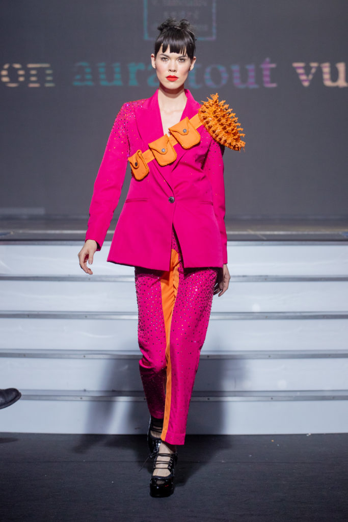 a model wearing  pink and orange  silk  outfit  crystal  and belt  by on aura tout vu haute couture spring summer 2020
