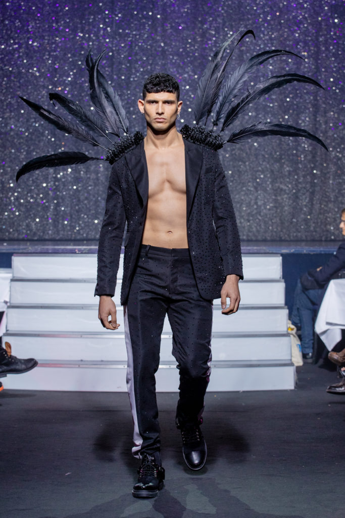 a men model wearing  black  silk  outfit  crystal feathers by on aura tout vu haute couture spring summer 2020