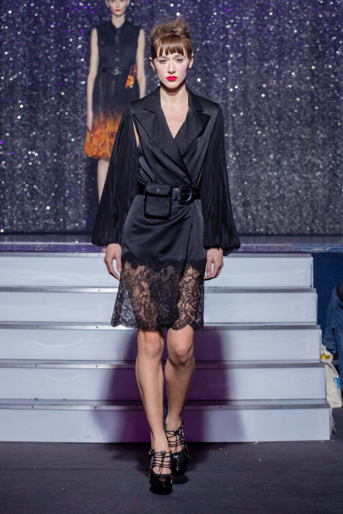 a model wearing  black japon silk  outfit  lace crystal  and belt  by on aura tout vu haute couture spring summer 2020