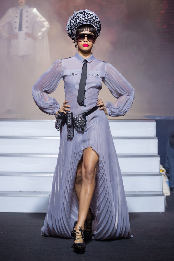 a model wearing Military gray dress pockets and crystal belt eyewear by on aura tout vu couture spring summer 2020