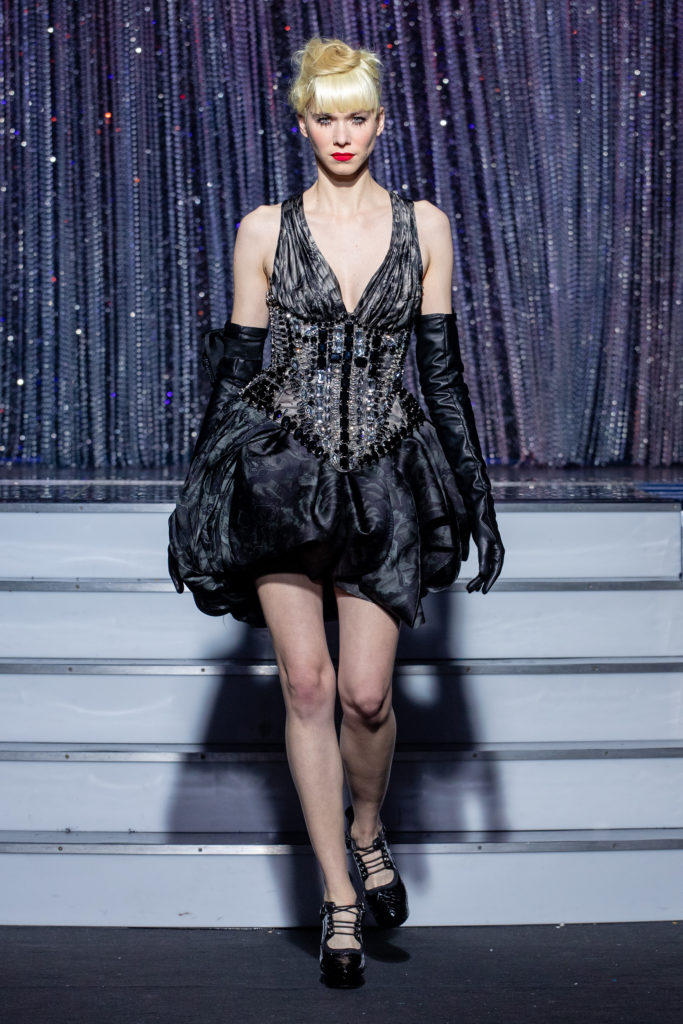 a model wearing black outfit  crystal  corset   by on aura tout vu haute couture spring summer 2020