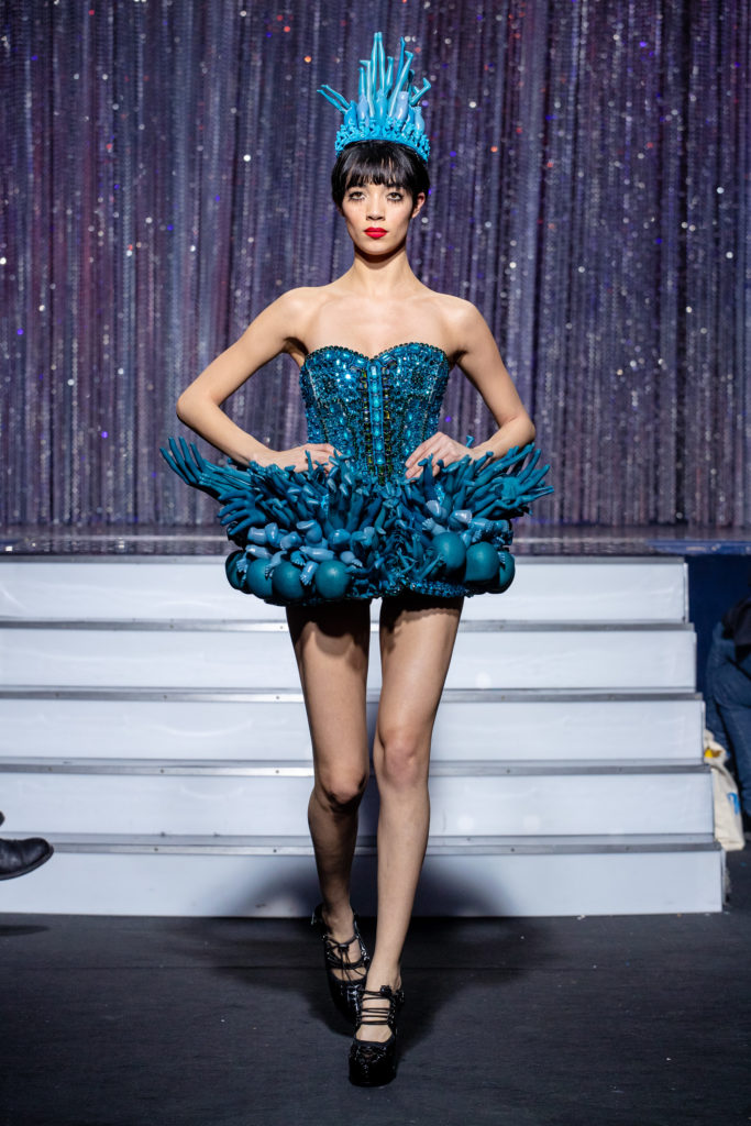 a model wearing  bleucrystal corset and dolls outfit  by on aura tout vu haute couture spring summer 2020