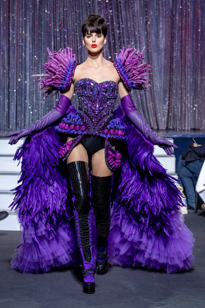 a model wearing  purpple crystal corset  outfit  crystal  and feathers  by on aura tout vu haute couture spring summer 2020