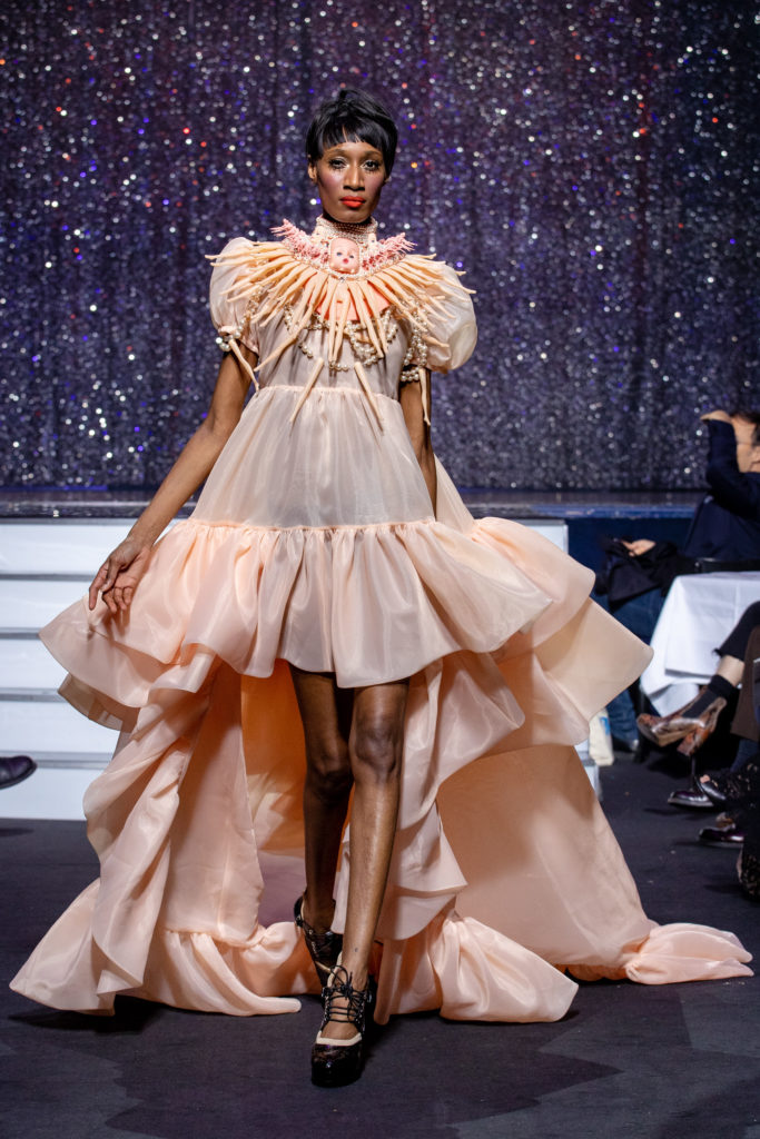 a model wearing  pink silk  outfit  crystal    by on aura tout vu haute couture spring summer 2020