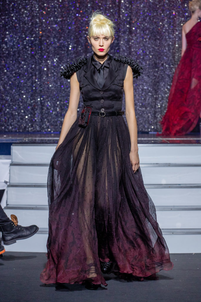 a model wearing  dark red silk  outfit  crystal  and belt  by on aura tout vu haute couture spring summer 2020