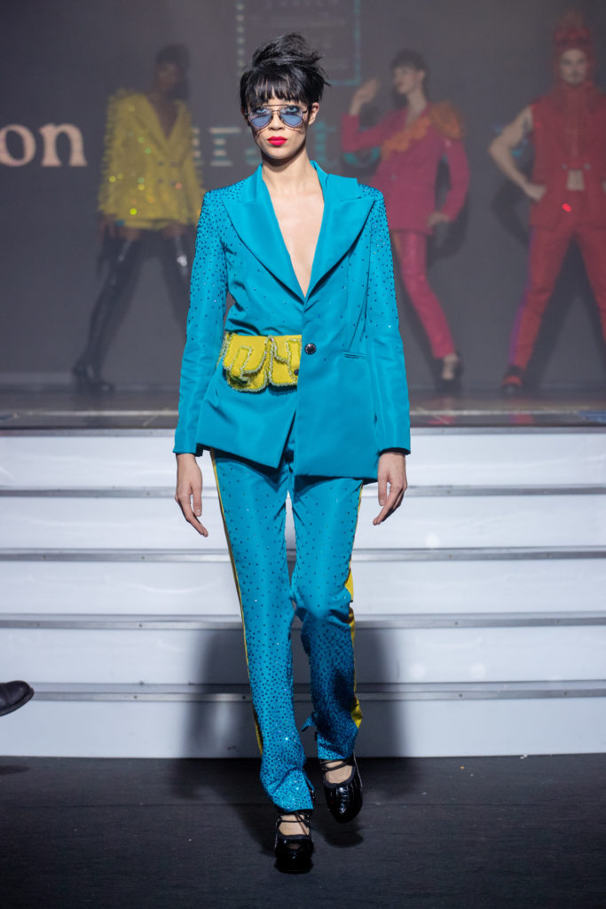 a model wearing  bleu and green  silk  outfit  crystal  and belt  by on aura tout vu haute couture spring summer 2020